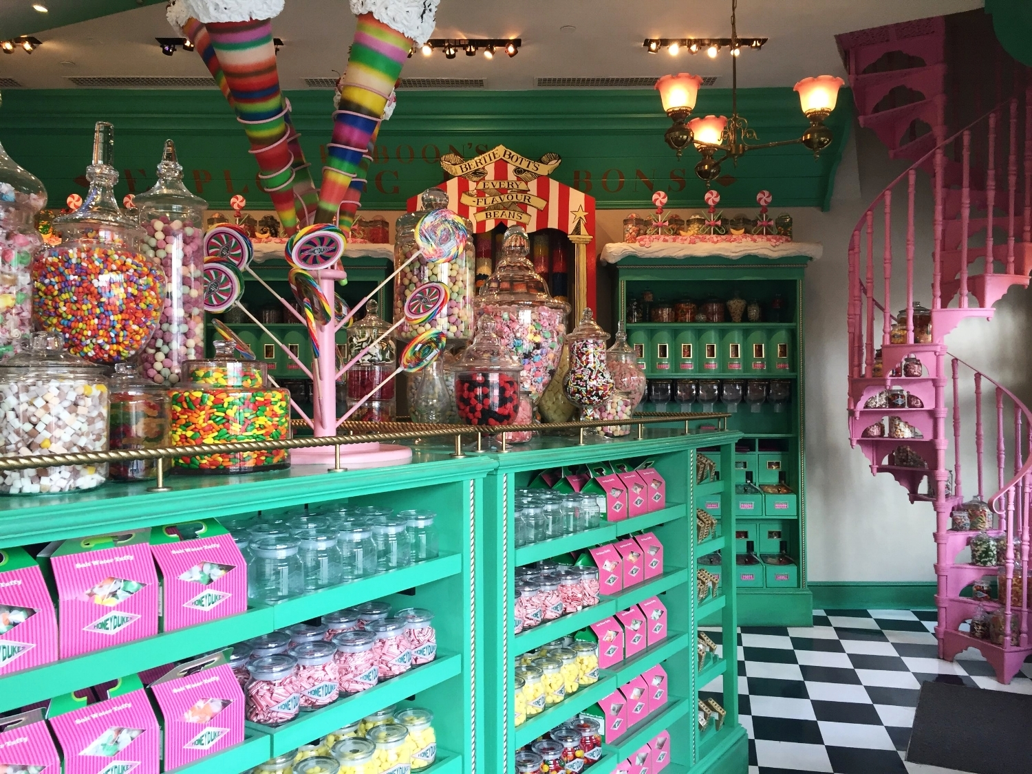 Honeydukes has peppermint green shelves and a cotton-candy pink spiral staircase.