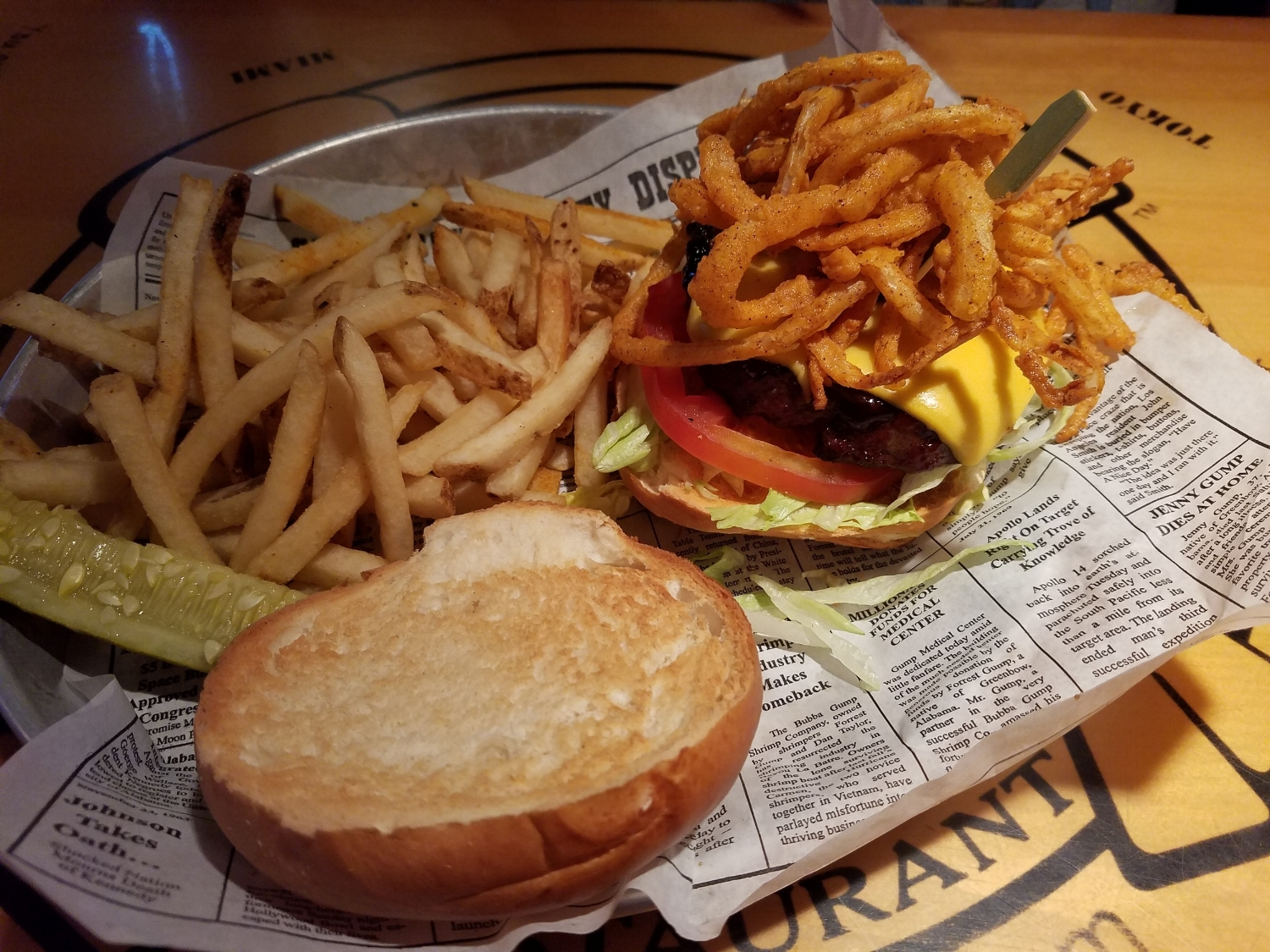 All American Cheeseburger with Frizzled Onions, BBQ Sauce, and Fries from Bubba Gump Shrimp Co.