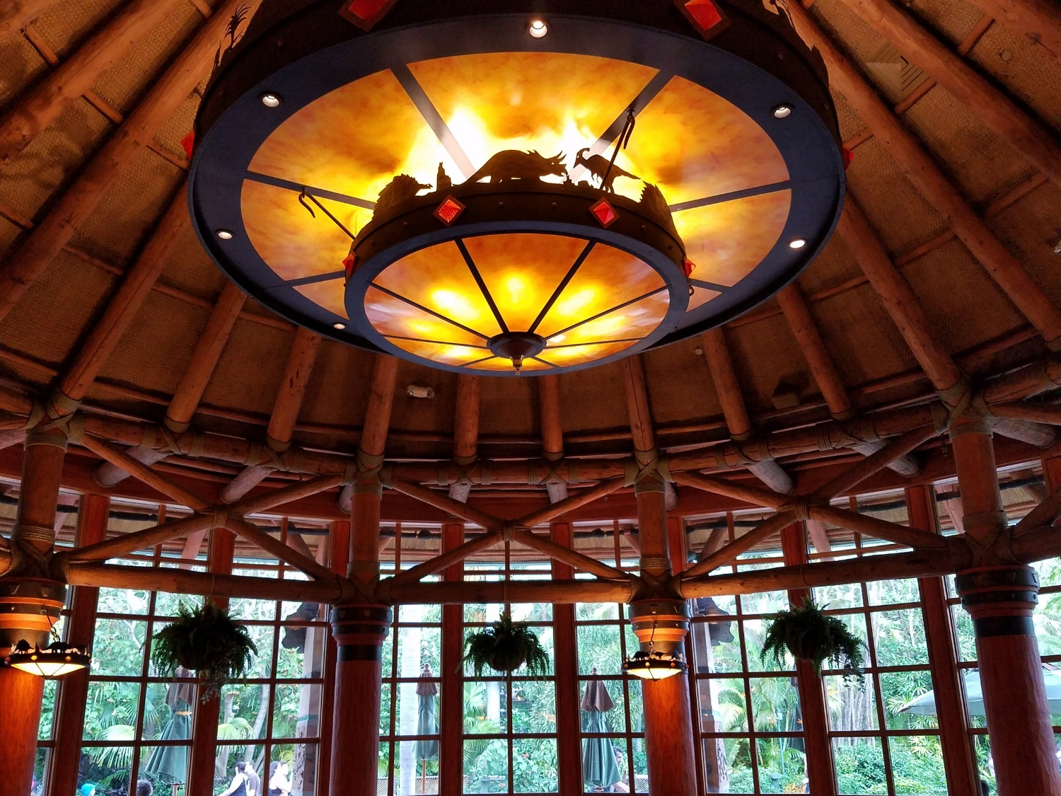 Light fixture and hanging plants inside Thunder Falls Terrace.