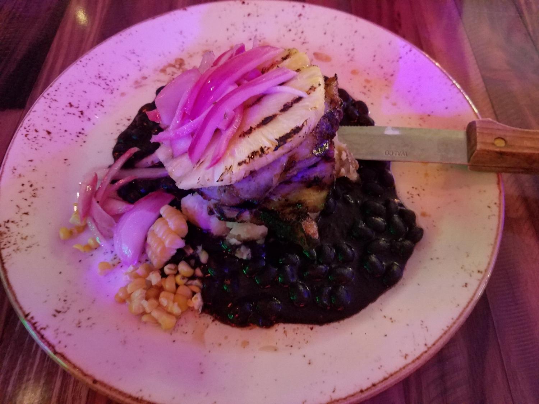 Pork Loin (cilantro grilled mojo, boniato mash, black beans, roasted corn, grilled pineapple) from Antojitos