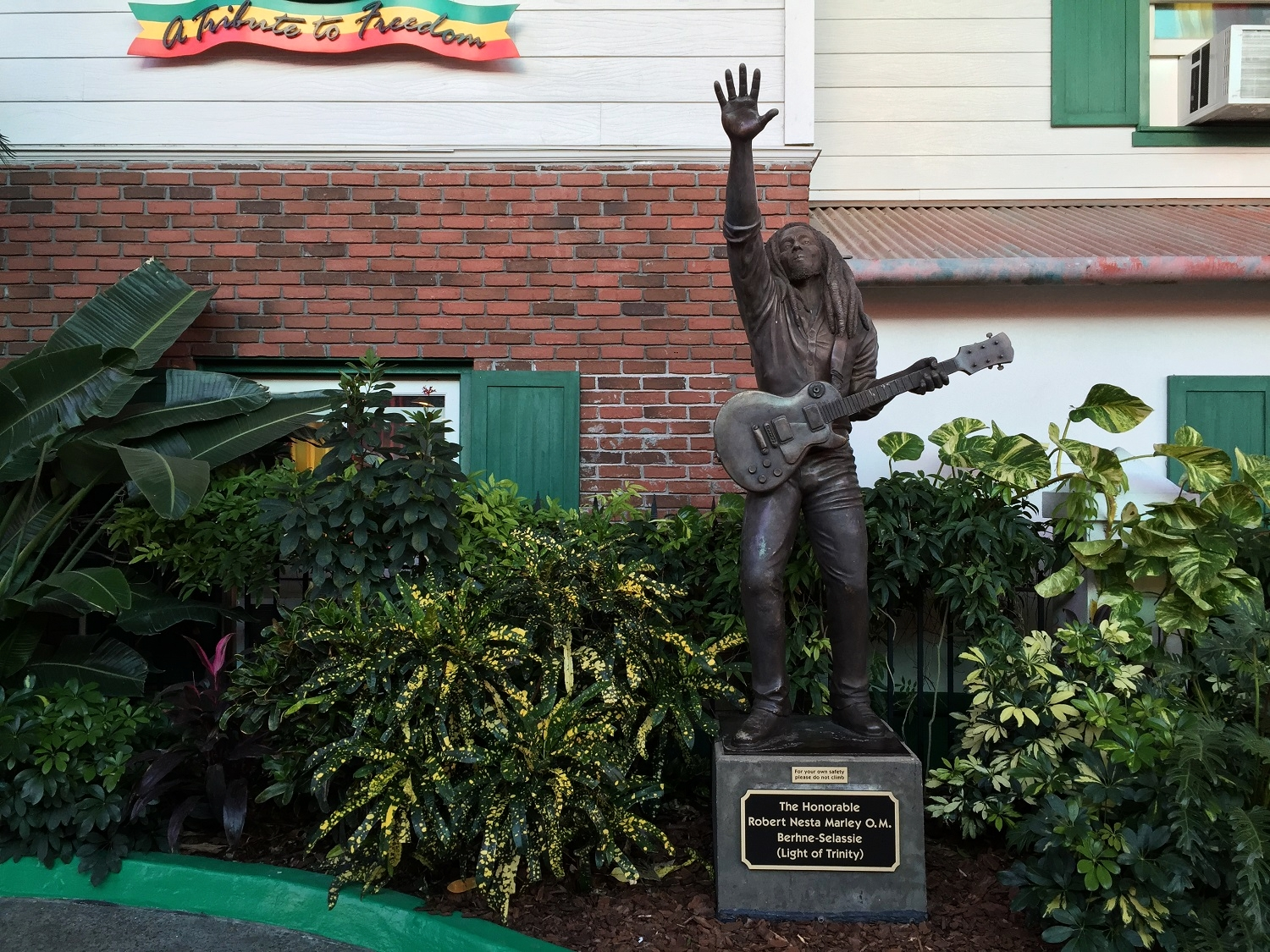 There is a Bob Marley statue in front of Bob Marley - A Tribute to Freedom.