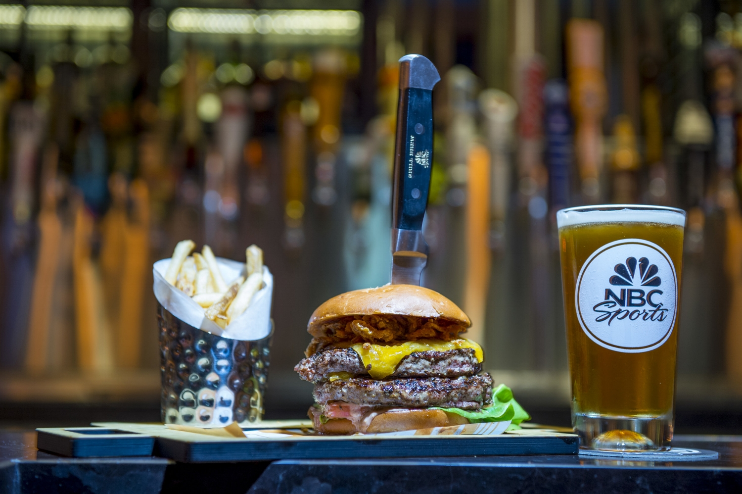 Grand Slam Burger, Fries, and Beer from NBC Sports Grill and Brew.Image credit: Universal Orlando Resort.