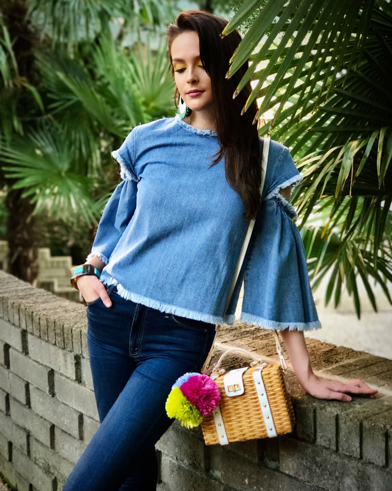 Chambray top by Tanya Taylor, Mother Denim Ankle Fray jeans, Ancient Greek sandals, jewelry by Ashley Pittman, pom pom purse by Milly