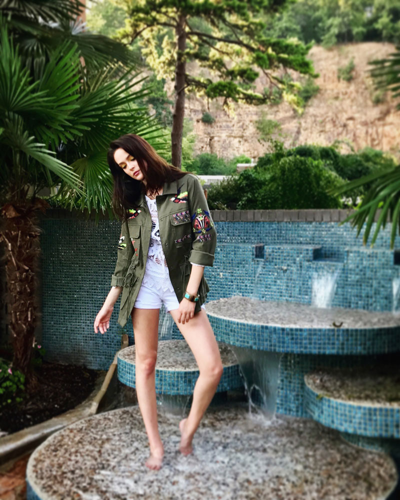 Embroidered army jacket by TanyaTaylor, denim shorts by DL1961, crochet top by Love Shack Fancy