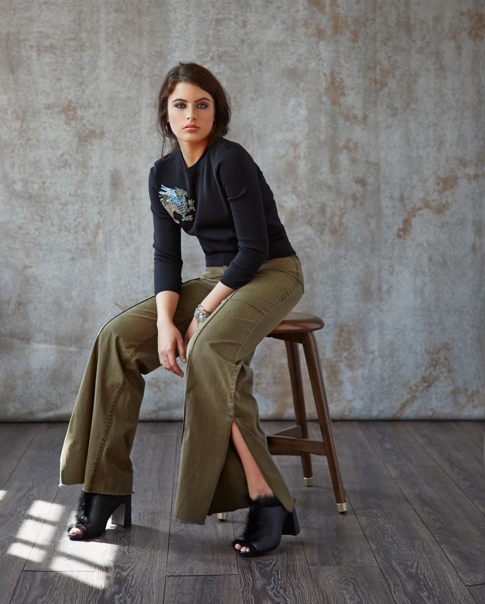 Alexander McQueen sweater, Cinq a Sept pants, Pedro Garcia fur-trim heels, Nan Fusco bracelets