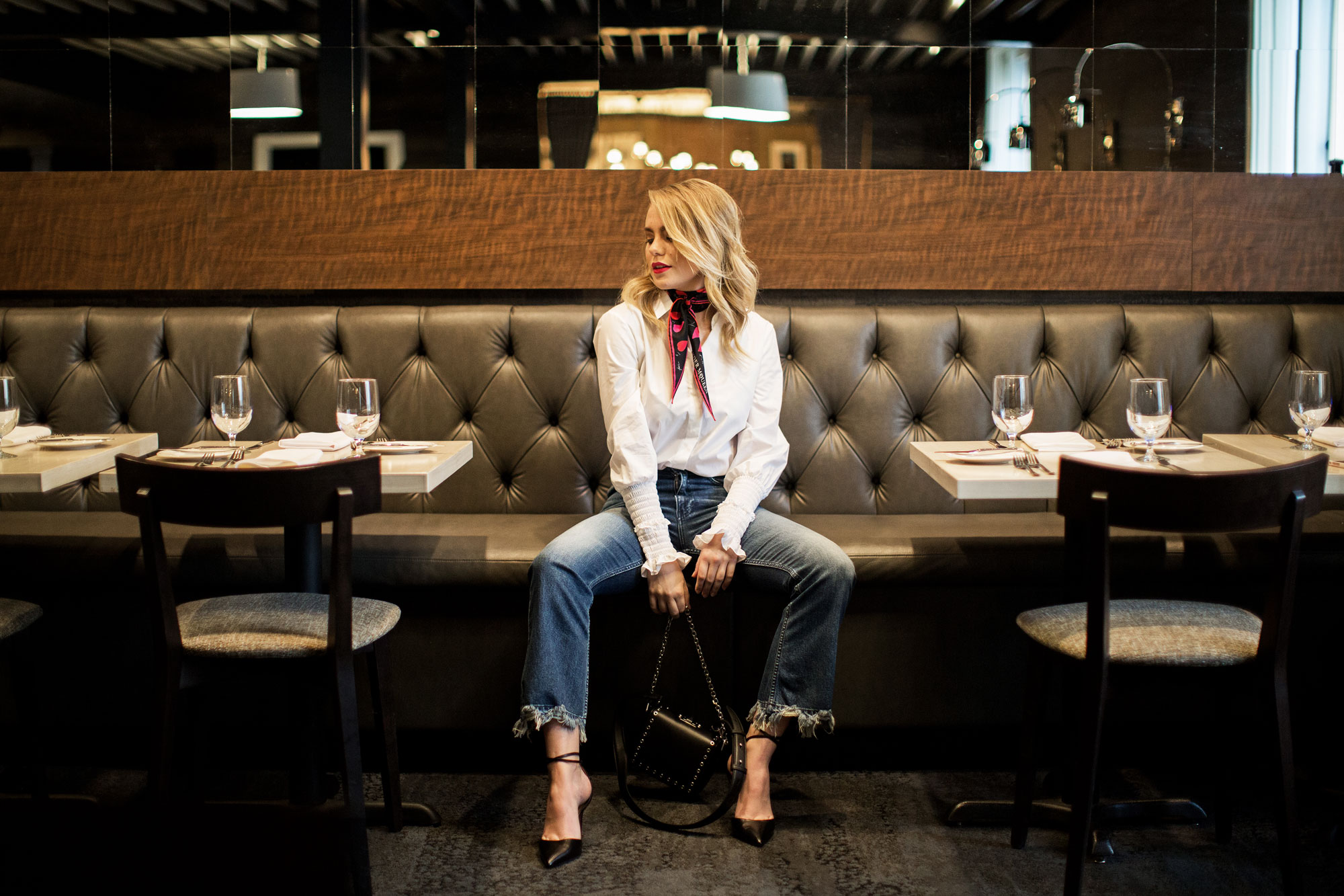 Alexander McQueen scarf and handbag; Altuzzara blouse; Mother Denim jeans; Aquazurra heels