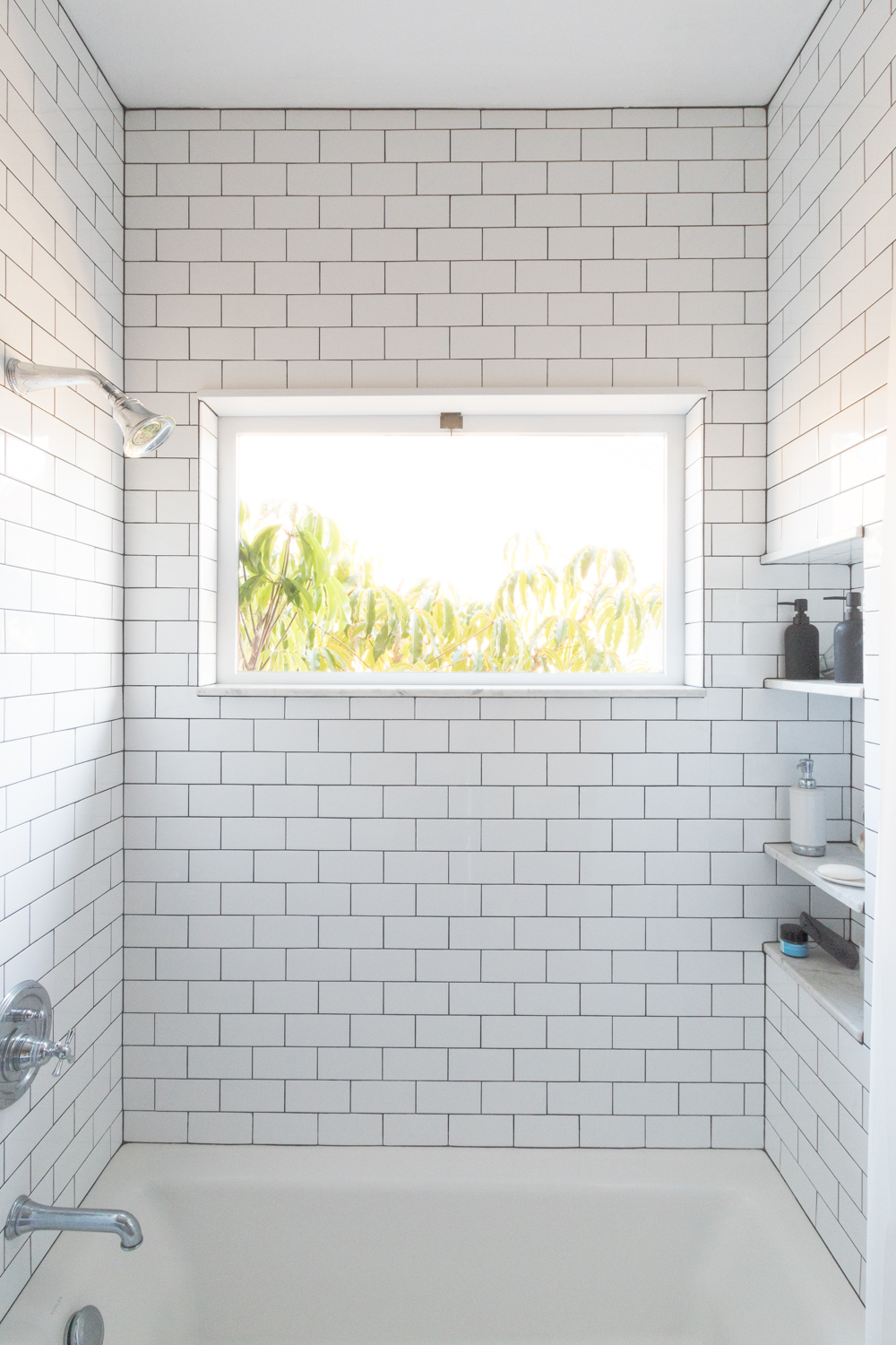 Subway tile to the ceiling in a shower