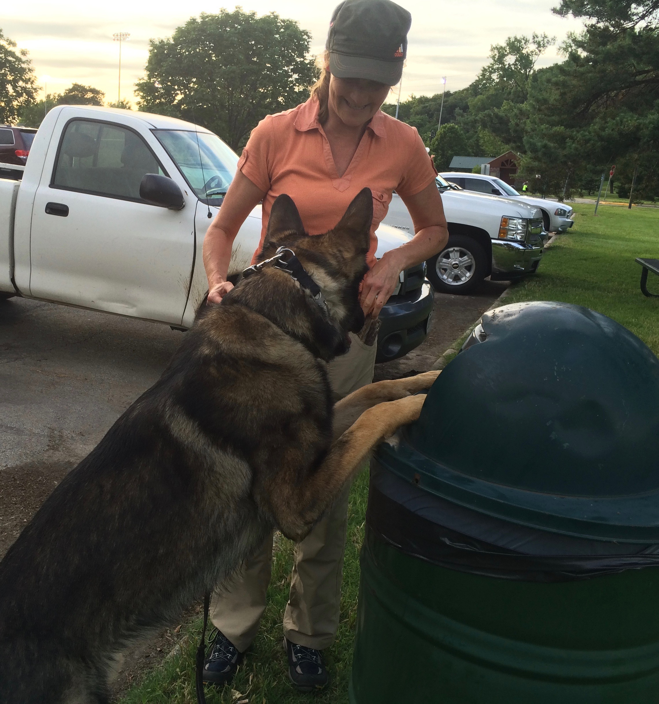 Darla Lilly  assists  Gregg  as he clears the park of trash.
