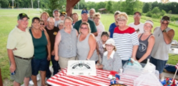 Members celebrated 95 years as a club with cake.