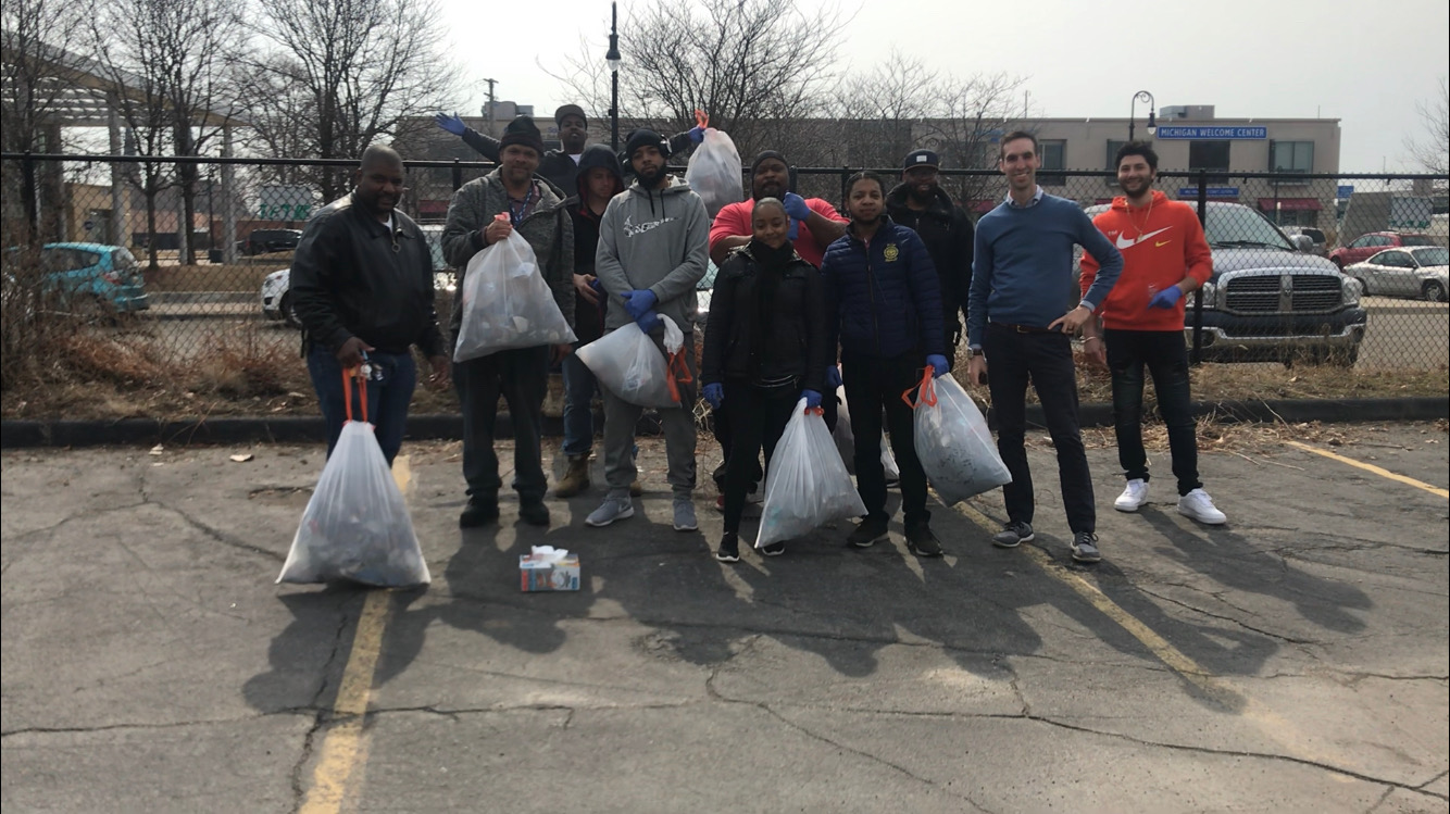 Paul Thomas MD with a group of students from the Detroit School of Digital Technology, cleaning up trash from our parking lot at 1759 21st Street, Detroit, MI 48216.