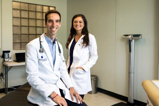 Paul Thomas MD and Raquel Orlich DO of Plum Health DPC, as recently featured in the Detroit Free Press. Photo Credit: the Detroit Free Press and  Kathleen Galligan.