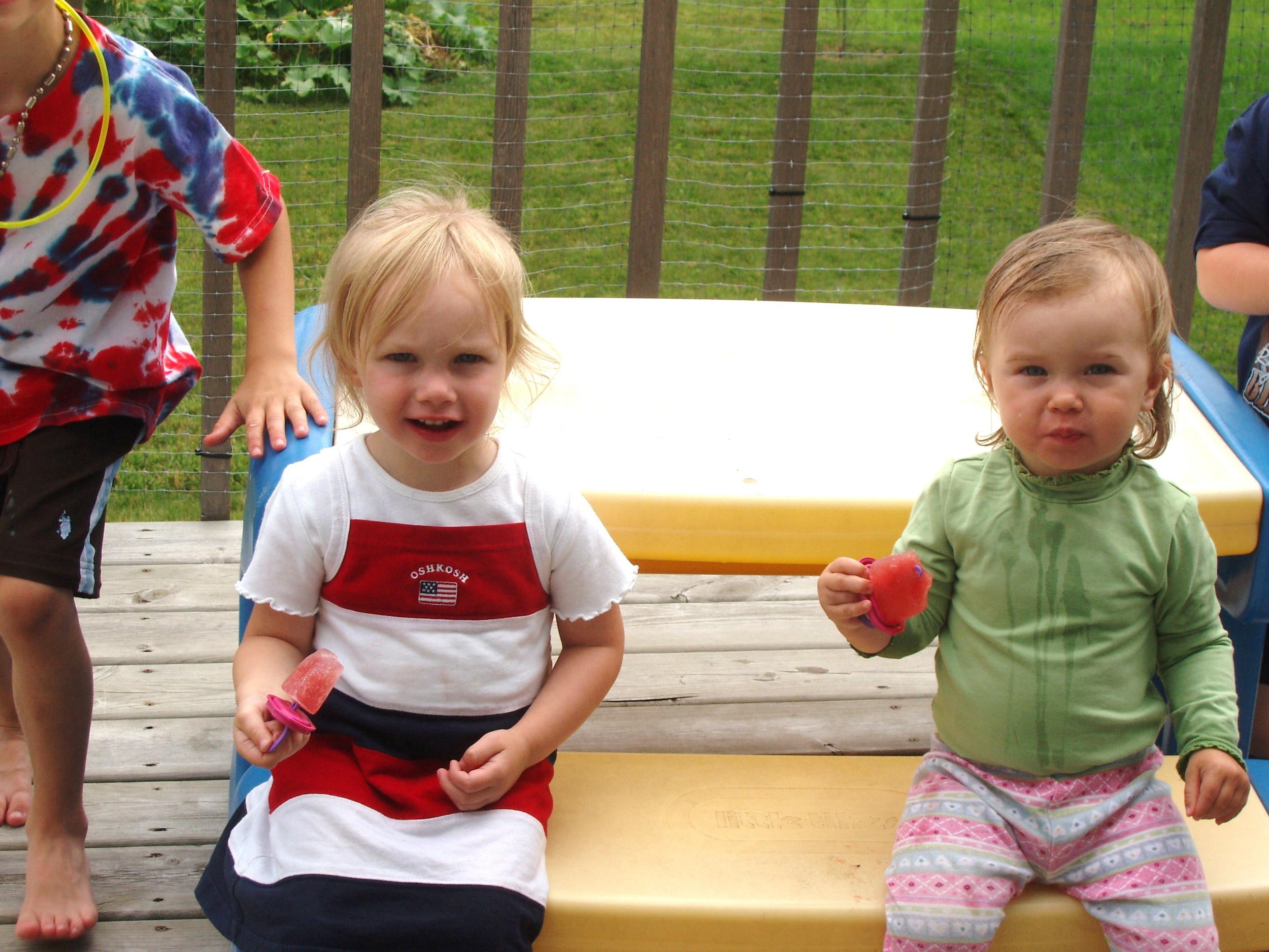 sasha & Hailey eating popsicles
