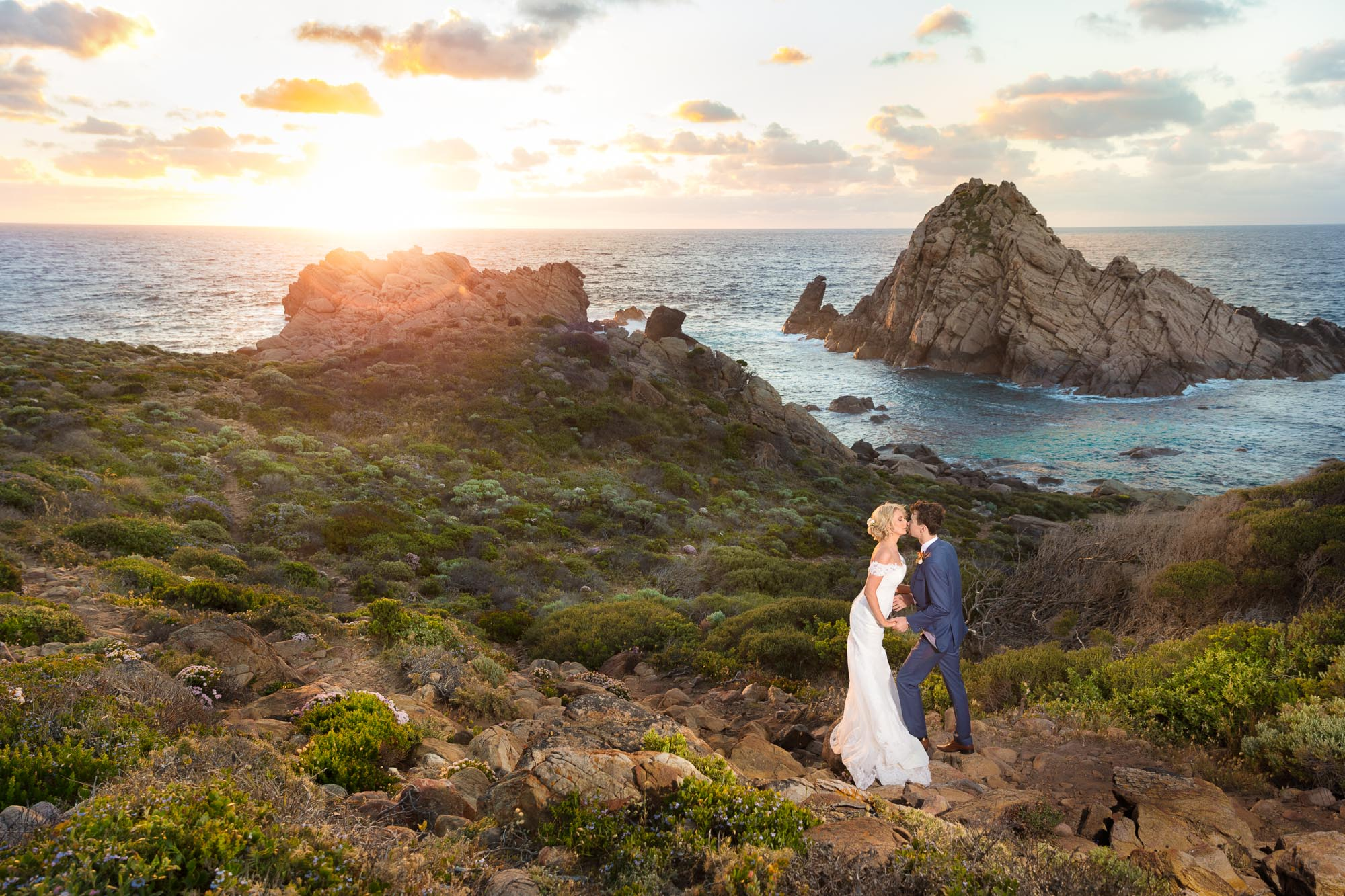 By many regarded as one of the nicest Wedding Portrait ever done at the Sugar Loaf Rock in Yallingup, by the now in Perth based Premier Portrait Photographer Kurt Nigg