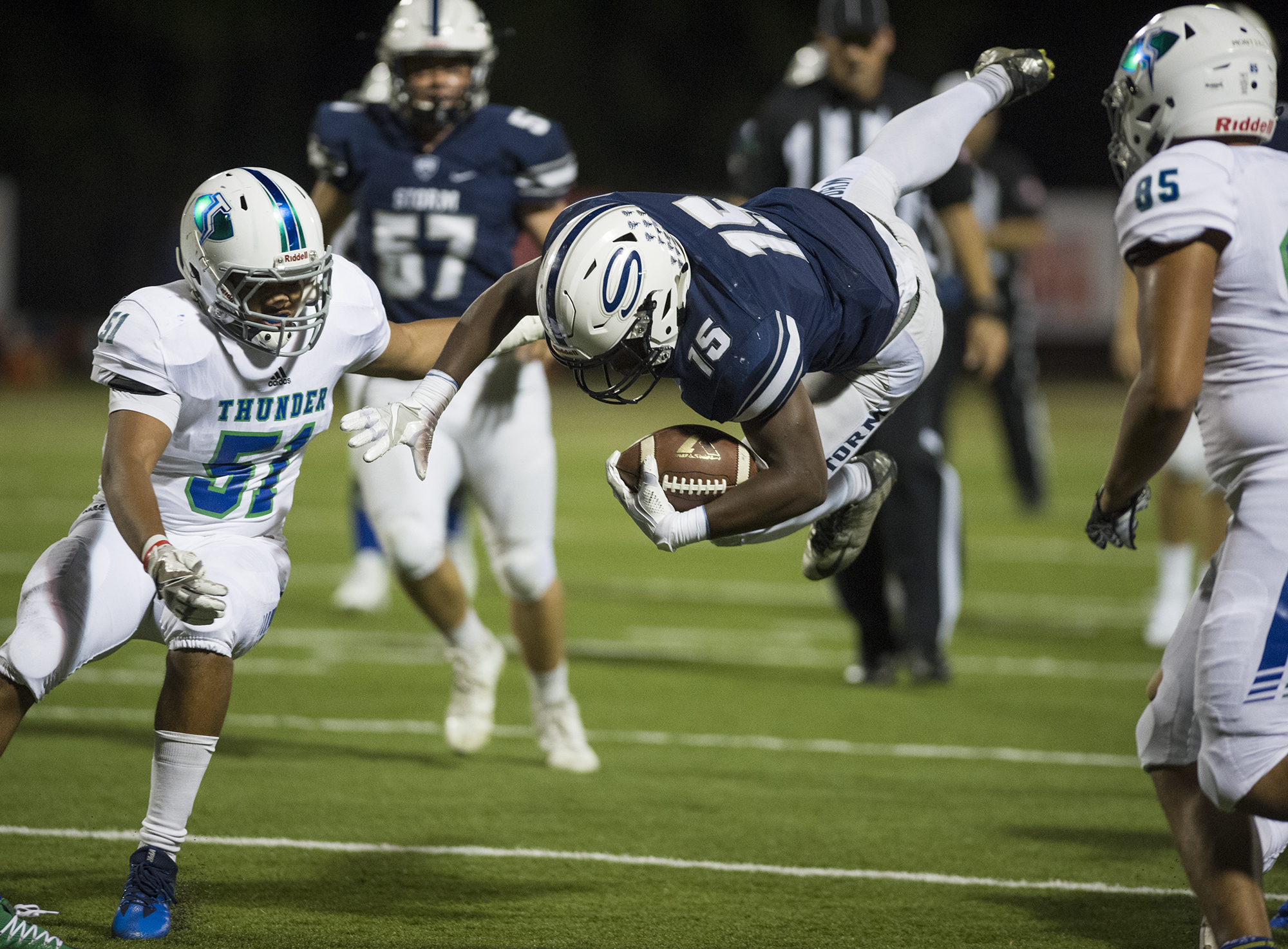 Skyview's Jalynnee McGee (15) soars past Mountain View's Kobe Anderson (51) during the first quarter at Kiggins Bowl in Vancouver, Friday September 22, 2017. (Ariane Kunze/The Columbian)