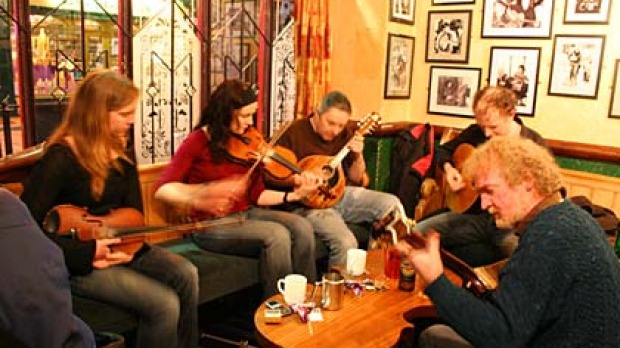 Traditional Music Galway   Galway is renowned for it's amazing traditional music sessions, with insane talent playing in town at various hot spots and on the streets it is a vibrant, lively city with some of the best talent from around the world. Be sure to check out    Tigh Coili - sessions are on every night from 6.30-9.30 and at the weekends during the day. This is a very traditional, tiny bar based bang in the middle of the city centre, with a fantastic great atmosphere.    Taaffes   - right in the city centre, folk music and trad sessions every day.    The Crane - extremely well renowned trad music venue. Pop in any time to see if there's a session on. There are 2 floors to choose from, the upstairs doesn't normally open until the evening.    The Quays - awesome Irish music every night of the week. They get great talent in here and it's a great place to meet people.  See  the Galway City Pub Guide's page  for more traditional music sessions in Galway.