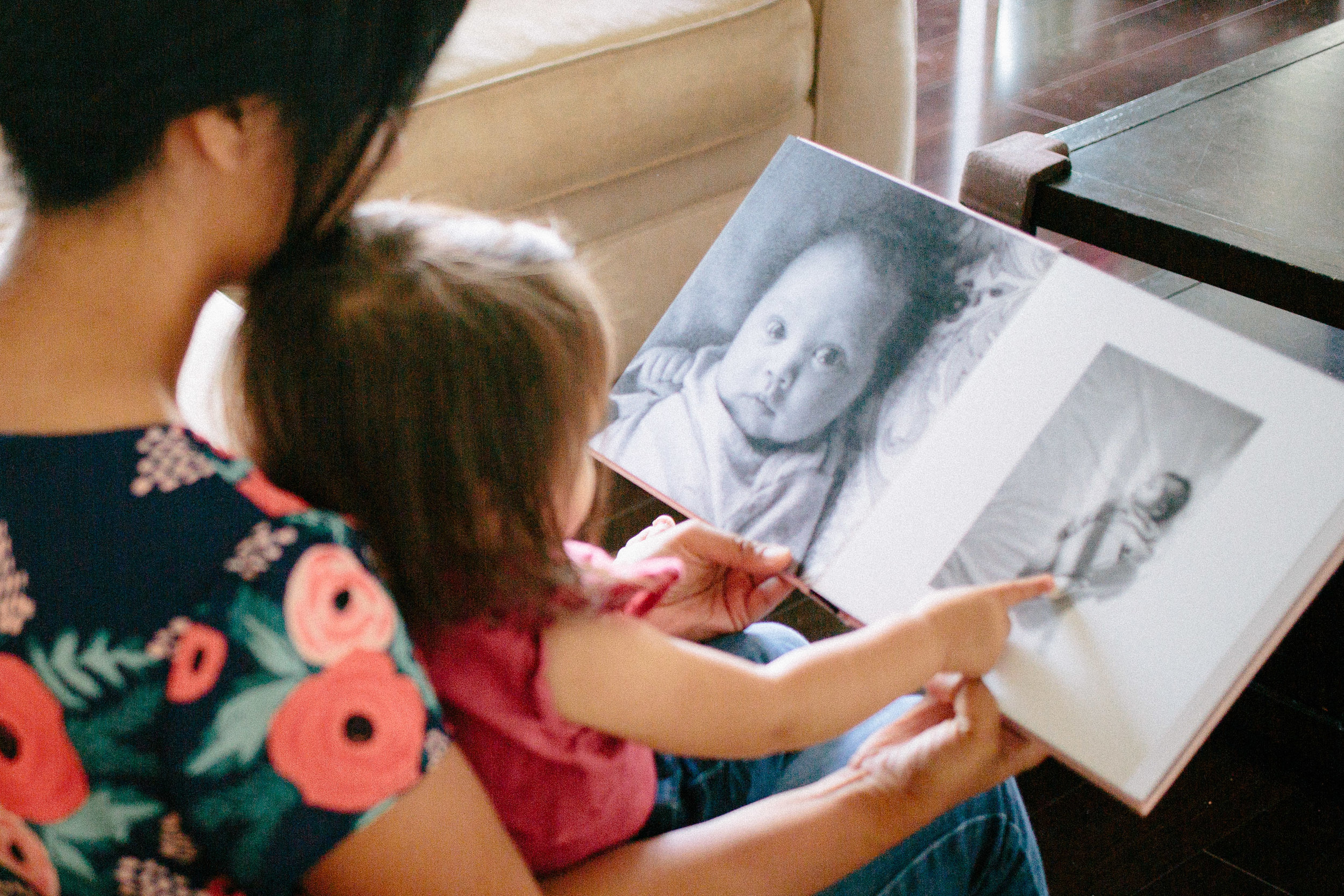 Showing Amelia her book of photos from the first year. She was so excited to see her face and kept saying 'Baby!'
