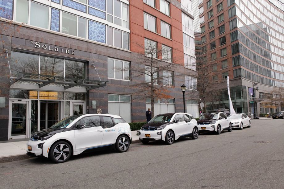 A row of electric BMW i3's that are part of a new car-sharing program being launched for residents of a Manhattan apartment building. BMW/ReachNow