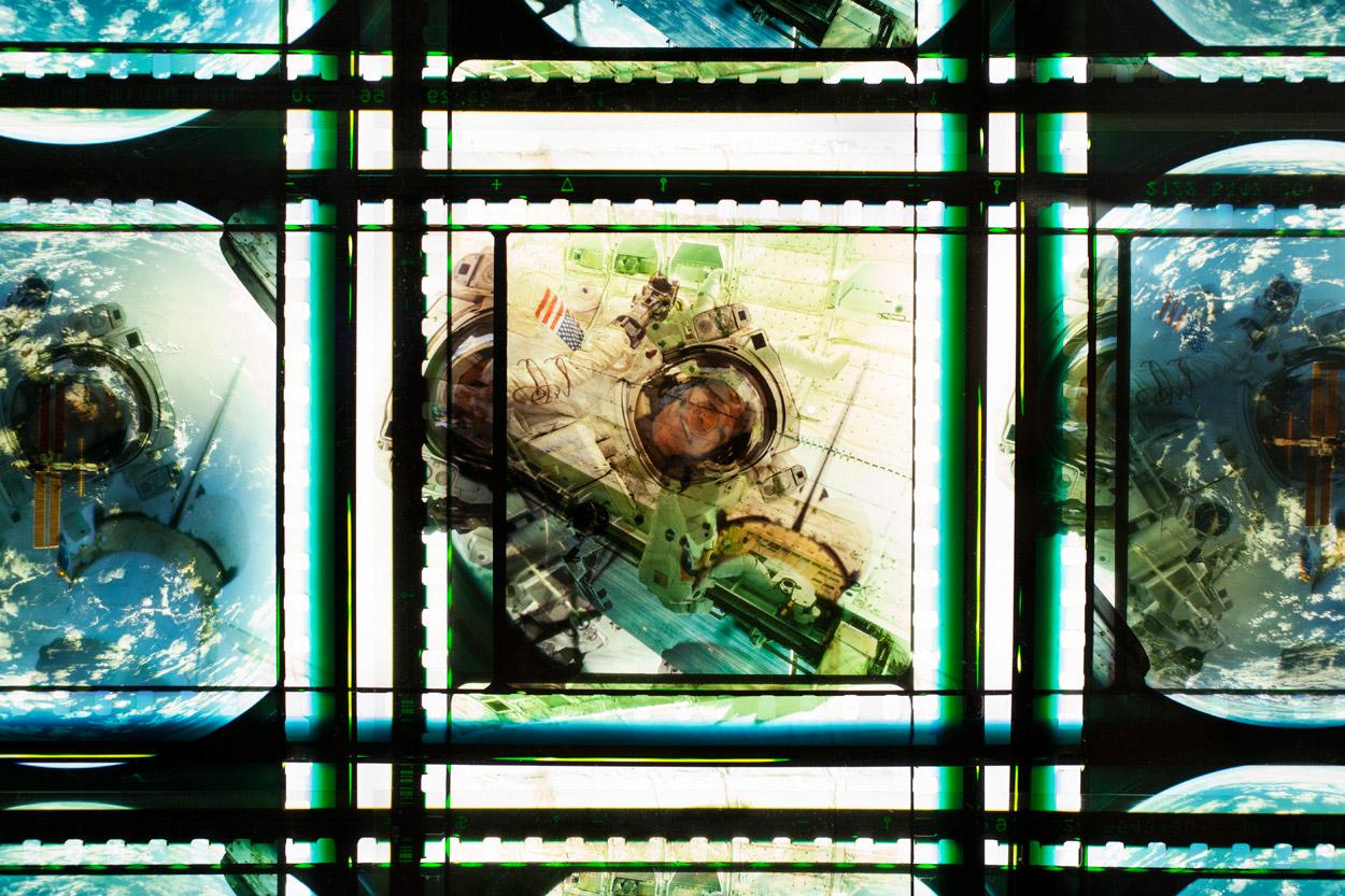Space Program  . 65mm IMAX Celluloid Film,  Fluorescent Lights, Plexiglas,  Custom Lightbox. 40  x40  x6.Richard Kerr. 2014. (Detail).