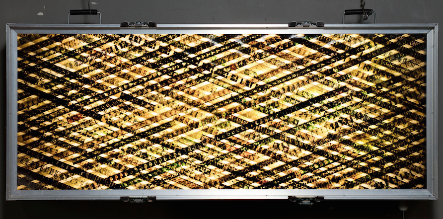 Heaven and Earth are About to Collide.  35mm Celluloid Film. Fluorescent Lights. Glass. Custom Lightbox. 60x30x8. Richard Kerr. 2004.  *Collected by TIFF Film Reference Library.