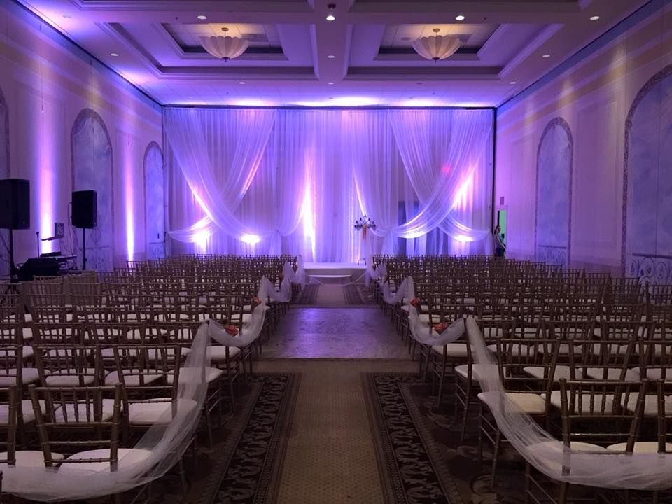 Purple Uplights in Ceremony