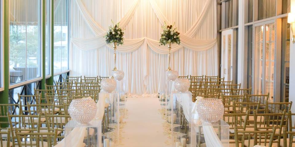 Criss Cross Ceremony Backdrop with aisle runner and ghost pedestals.jpg