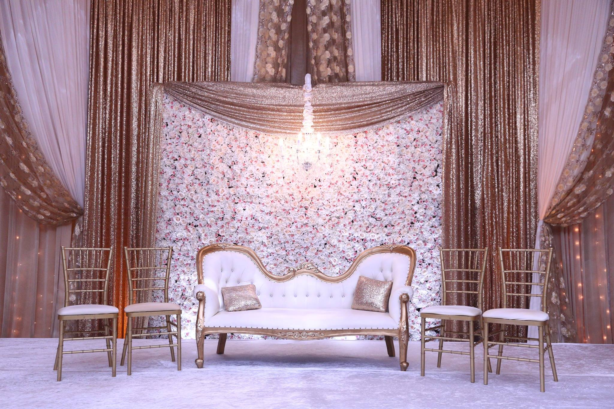 Gold Sequin Backdrop with Flower Wall Accent and Chandelier.jpg