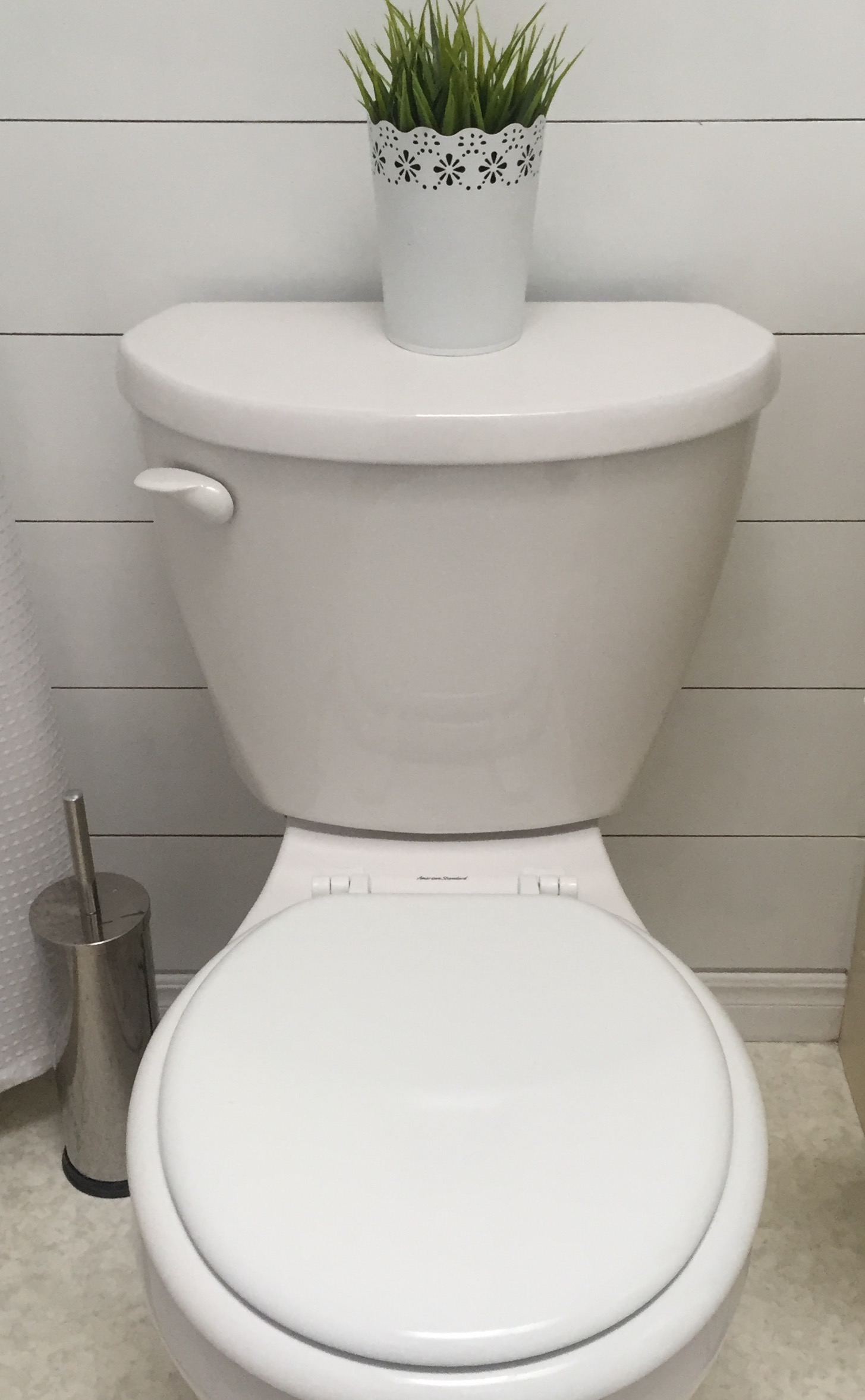 I replaced the wood toilet lid with a white one.