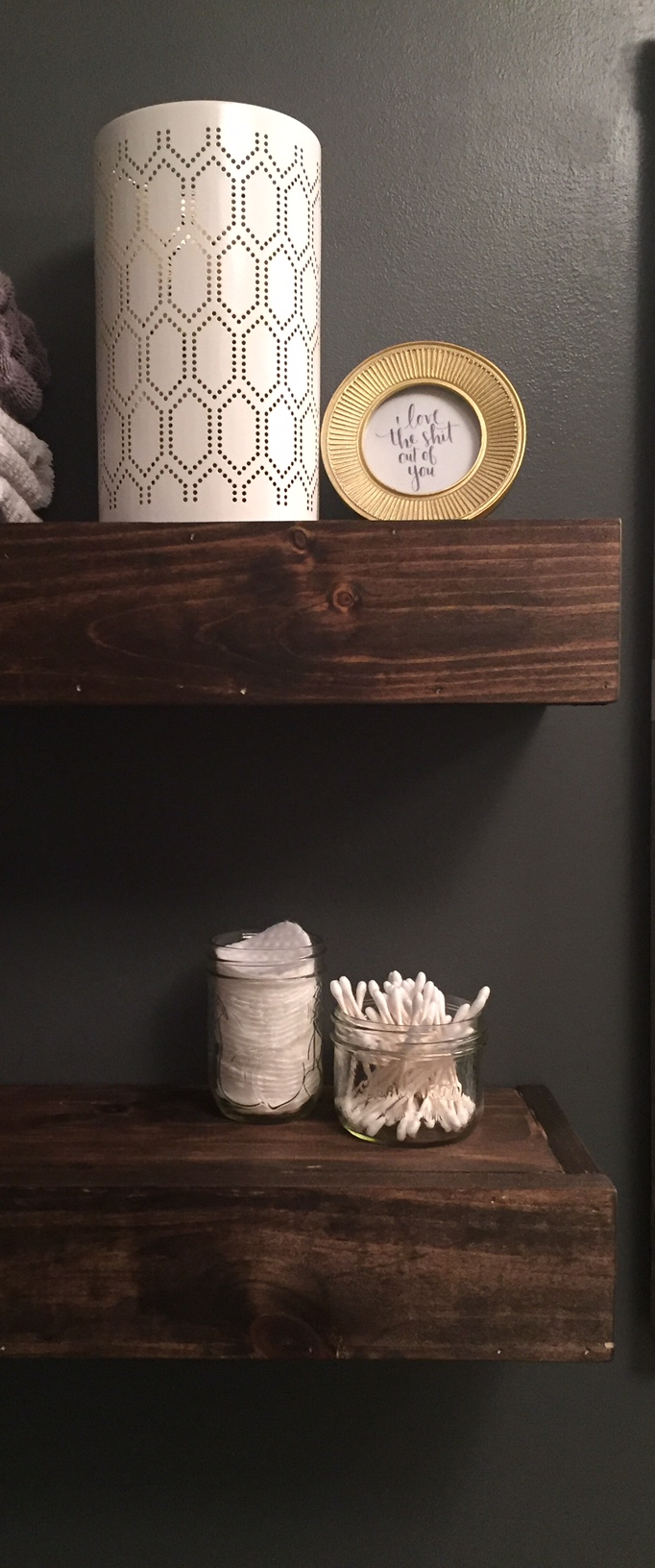 """The gold frame is from Homesense and I printed the """"I love the shit out of you"""" from Pinterest. Very fitting for a bathroom, no? :). I had the mason jars on hand."""