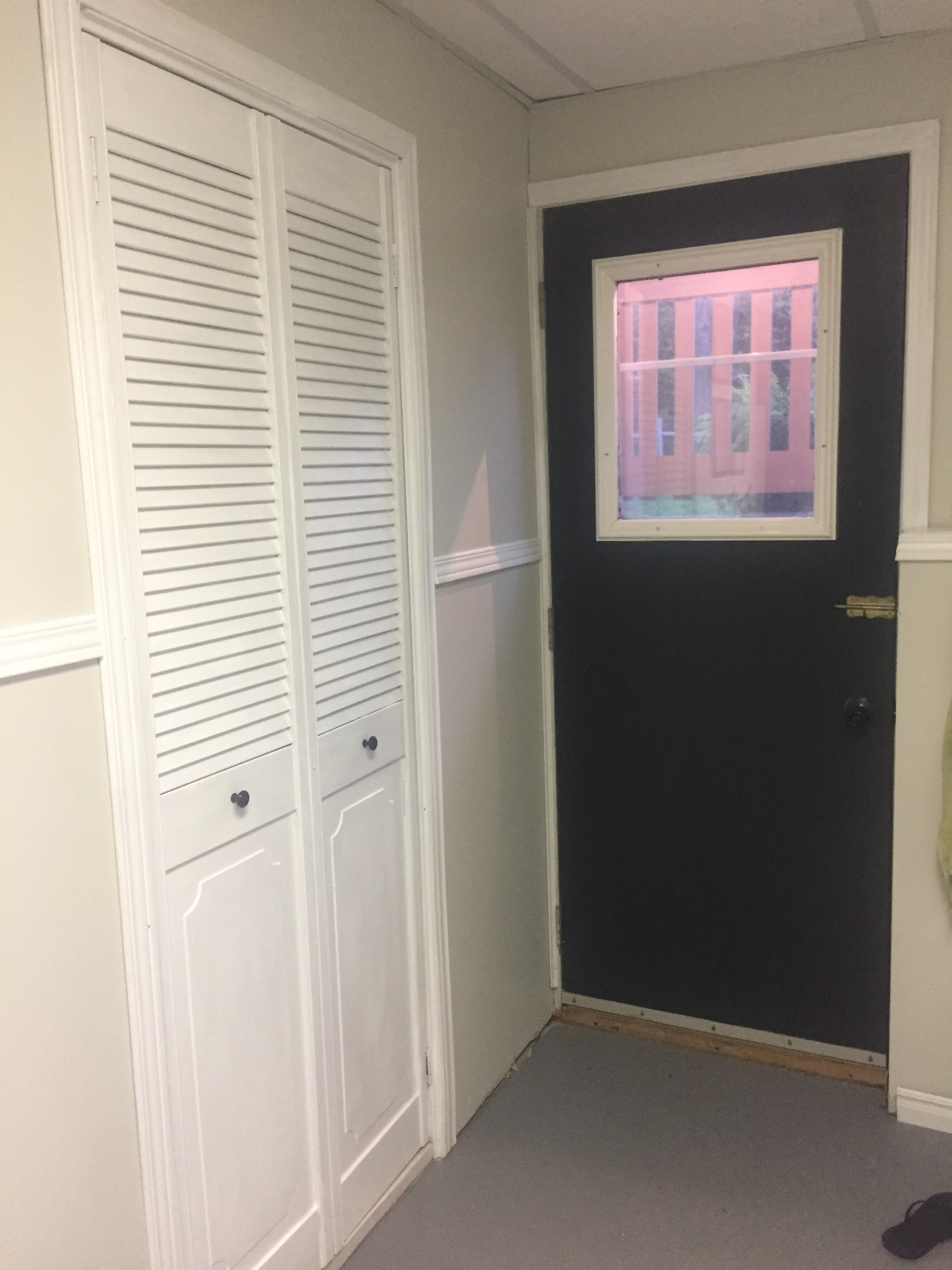 I also painted the back of the door to match the patio door and spray painted the door knob black (Which isn't even visible in this photo)