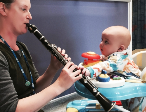 Ros Hawley playing clarinet to, for and with, baby Oliver.