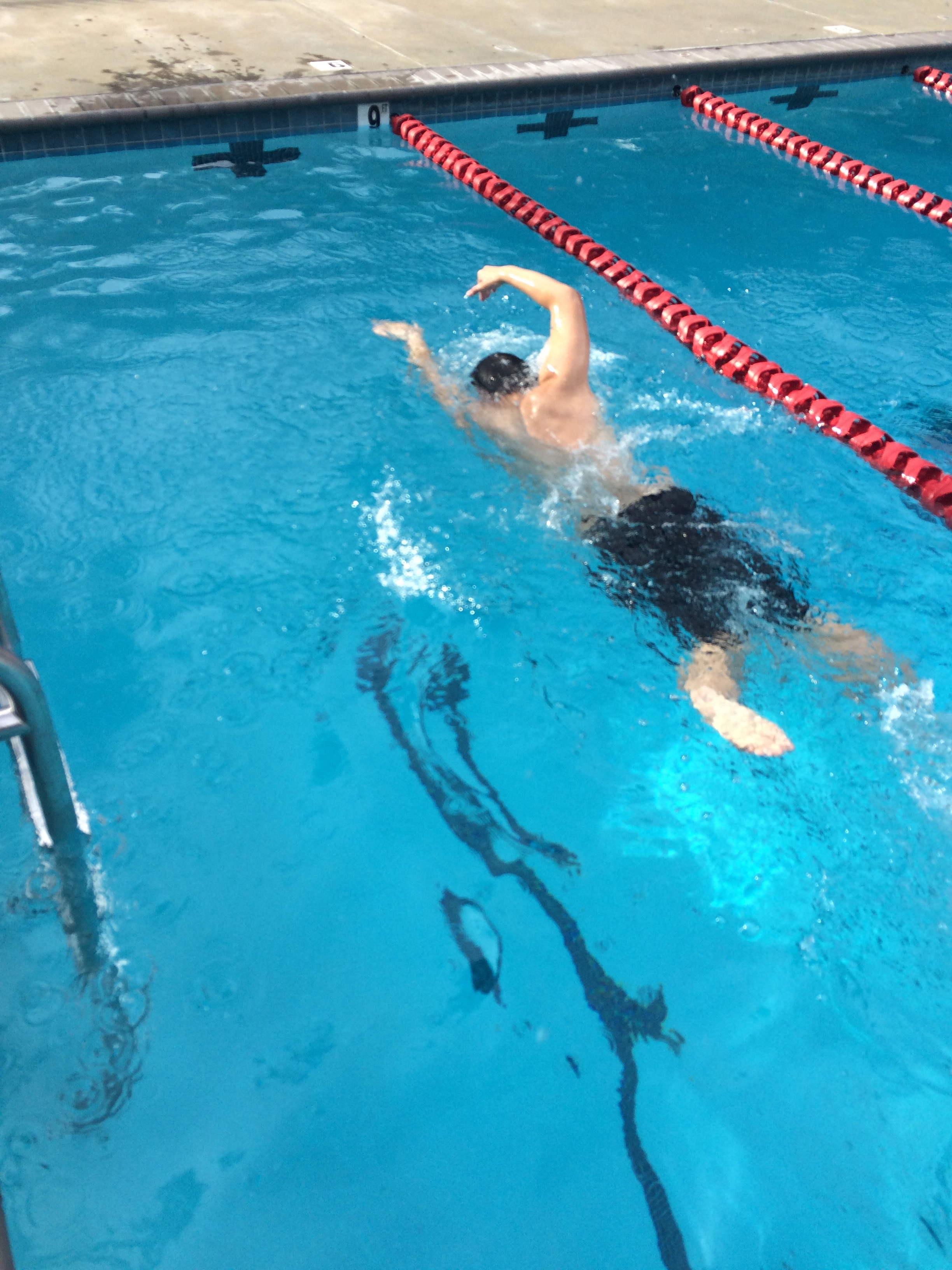 Young swimmer learning freestyle