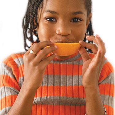 Girl eating orange.jpg