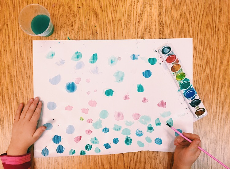 Four year old student experimenting with texture in watercolors