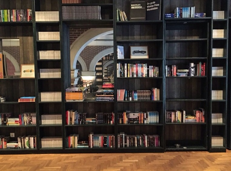 """The entire upstairs is styled as a public library, and the room entrances are """"hidden"""" doors."""