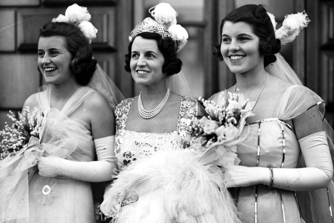 Kick (left) caused quite a stir as a London debutante. Here she is with mum Rose and sister Rosemary. Credit: Getty Images.