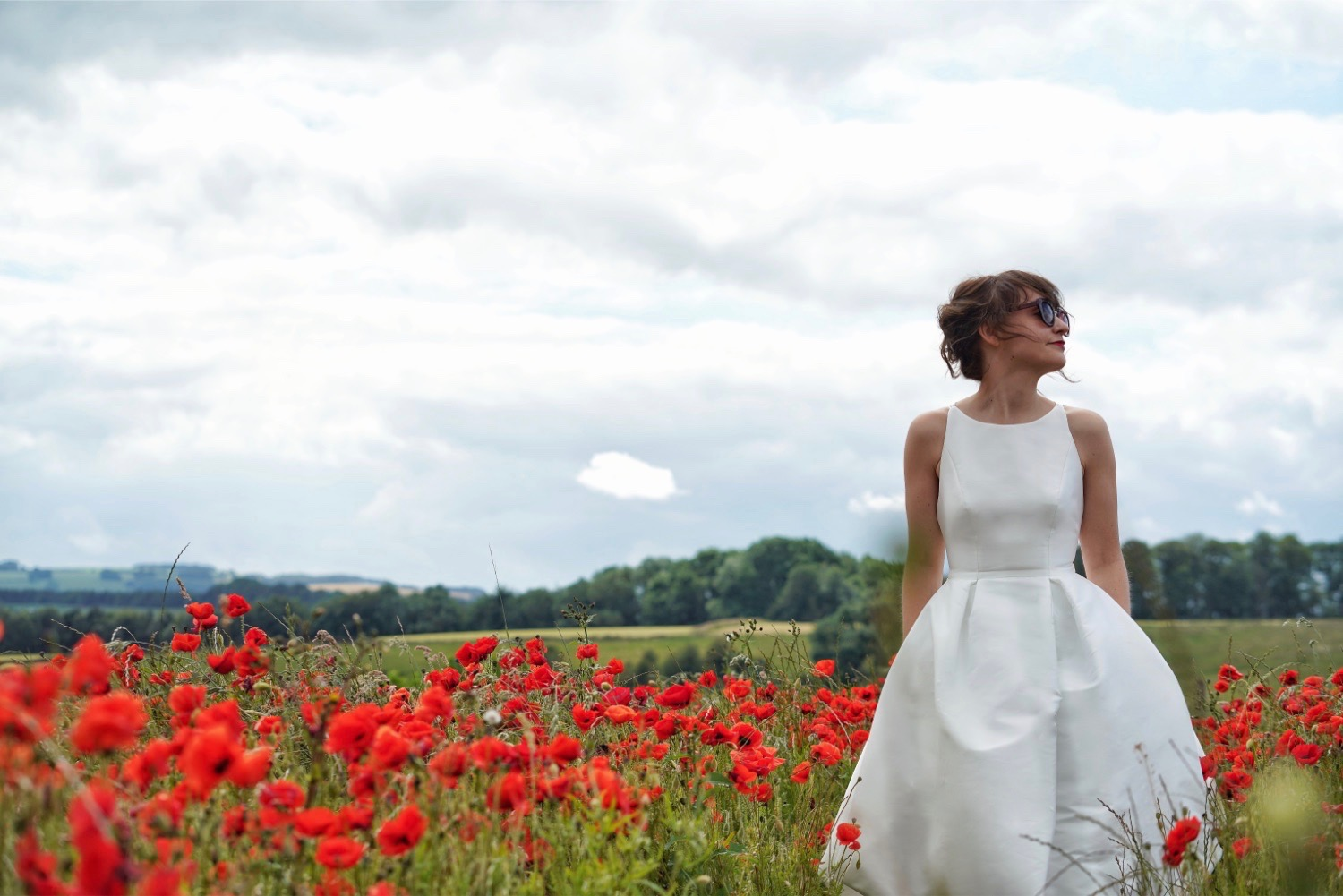I love the contrast of the structured Jesus Peiro 121 gown with the vibrancy of the poppy field. Shame you're already married Liv!