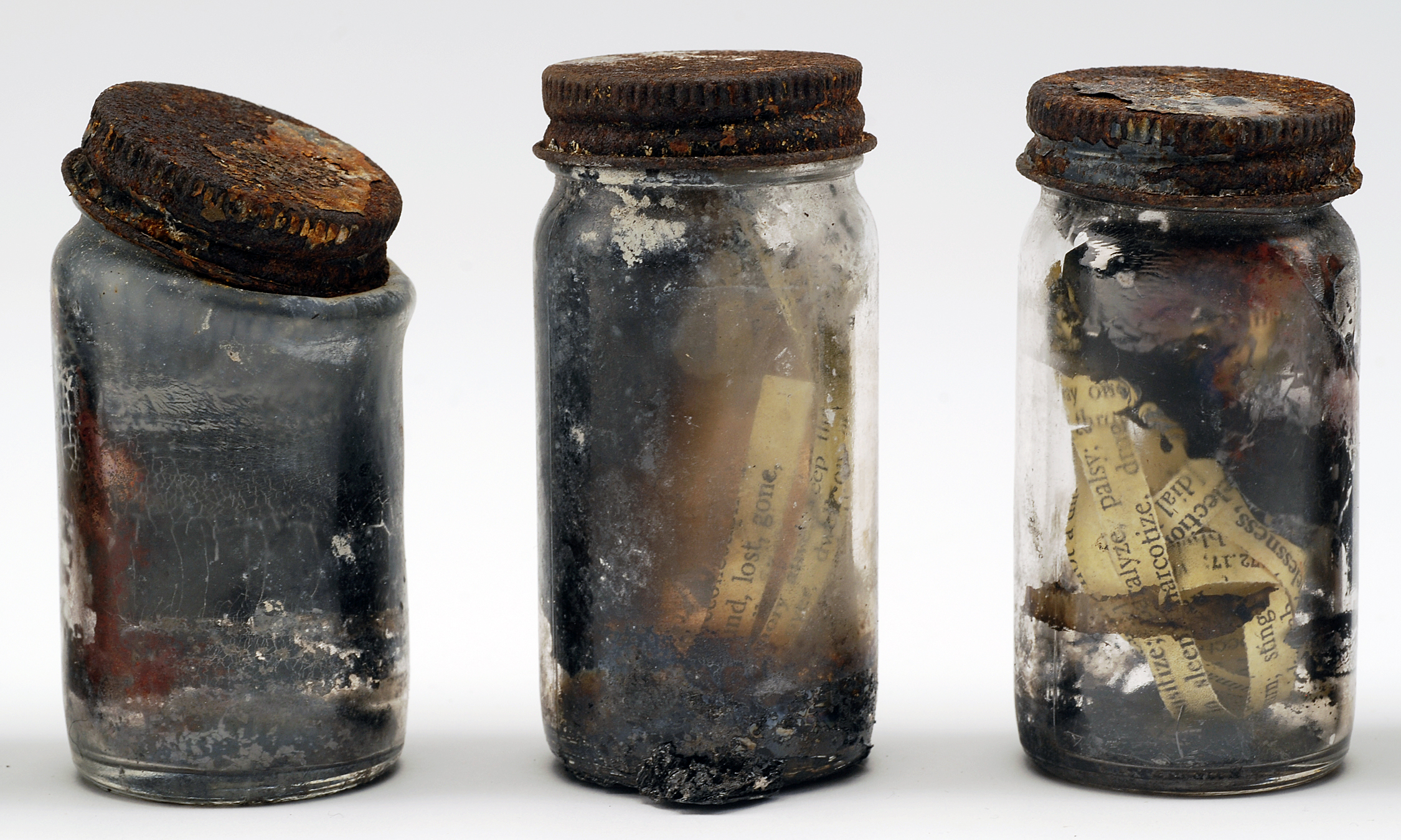 Anthony combs the ashes...Fourteen Jars 7-9.jpg