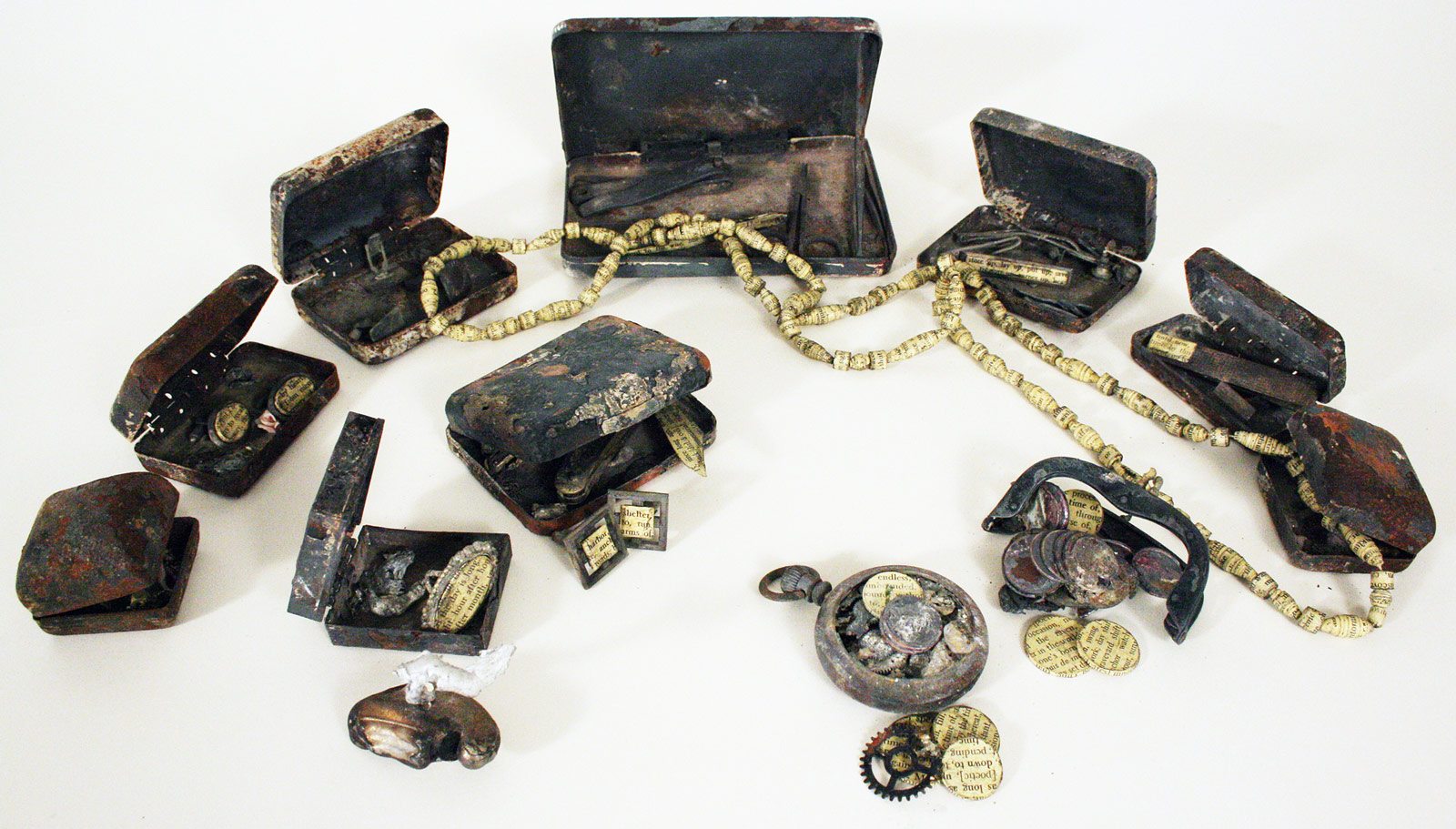 The siblings discover the remnants of their parents' romance: Nine jewel boxes, watch and purse