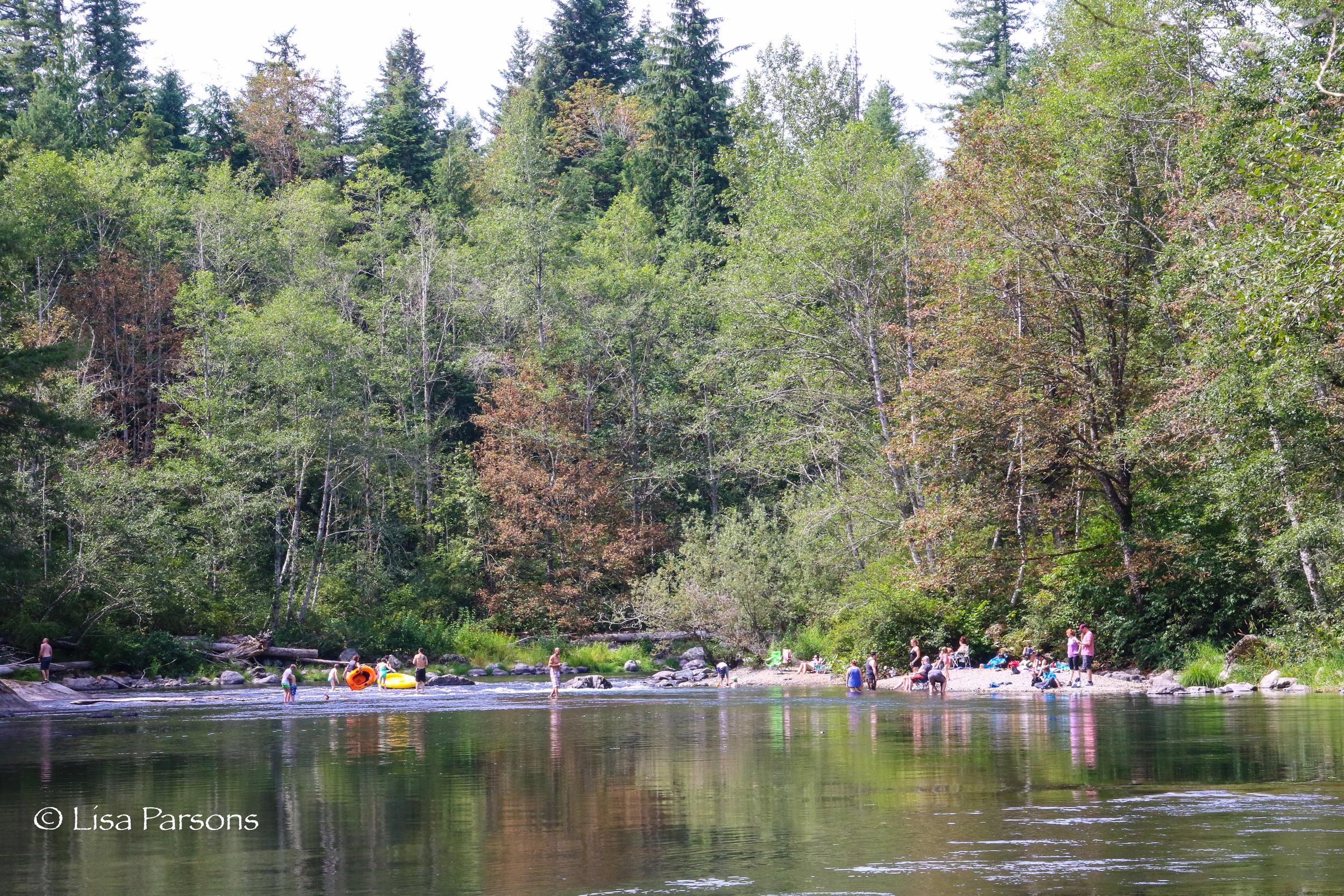Families Enjoying the River