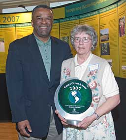 Doreen Johnson receiving the 2007 King County Green Globe award.   To her left past King County Executive Ron Sims    —Photo by by Ned Ahrens