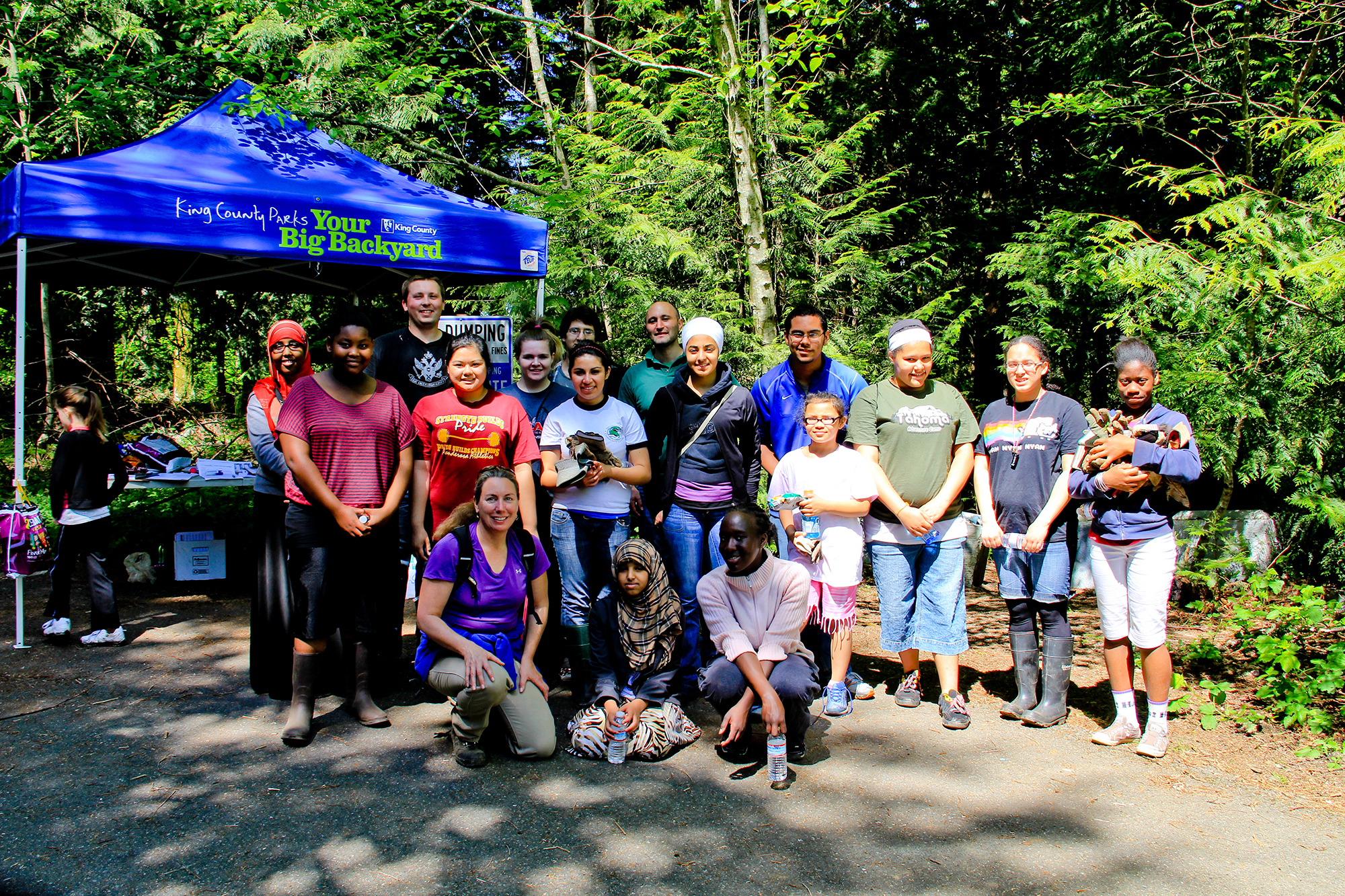 Lisa Parsons (bottom left) working with King County Parks and a group of students on the trails in Cedar Creek park