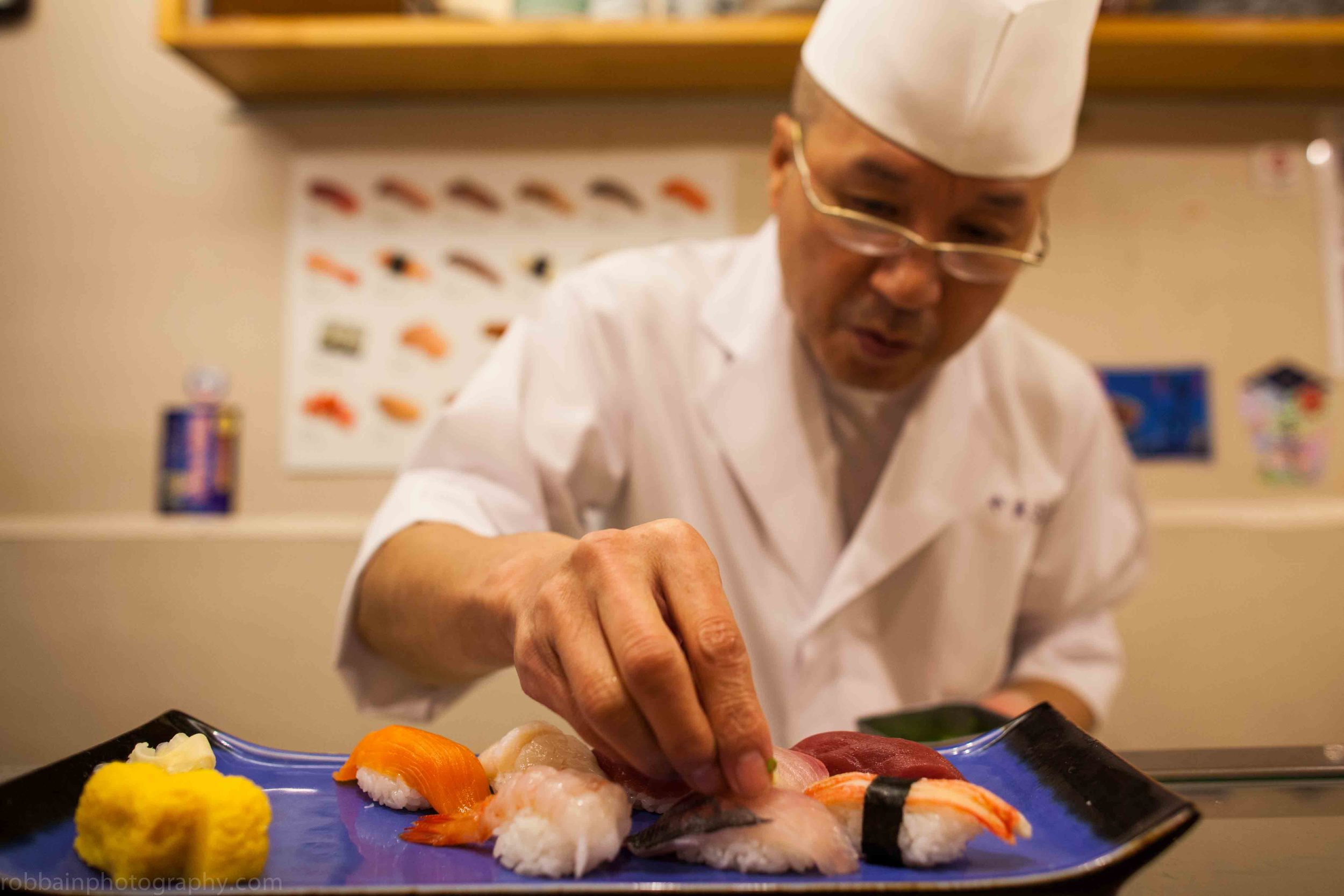 Photo 18. Sushi chef arranging dish.jpg