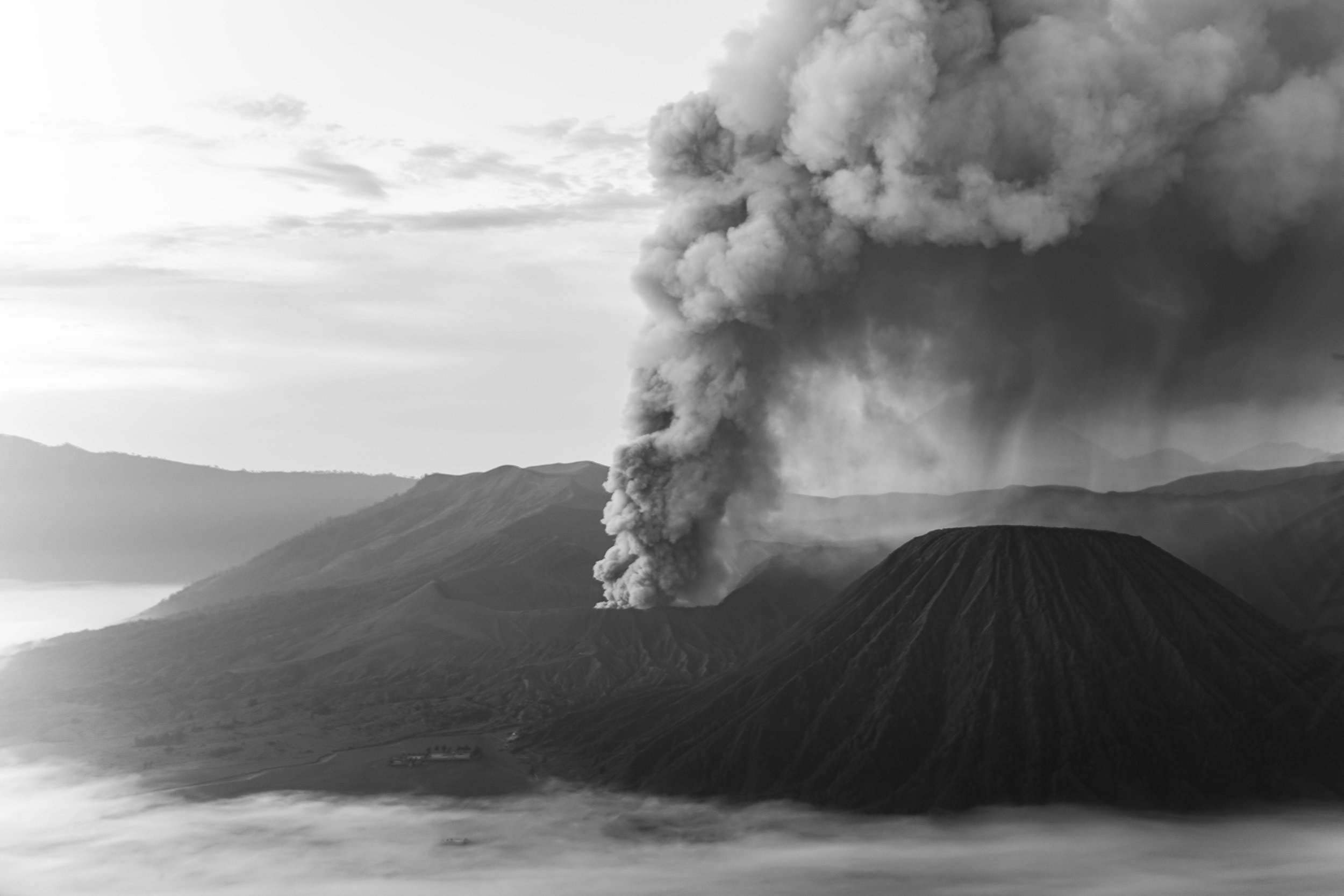 A view into the crater of Mount Bromo during heightened volcanic activity.