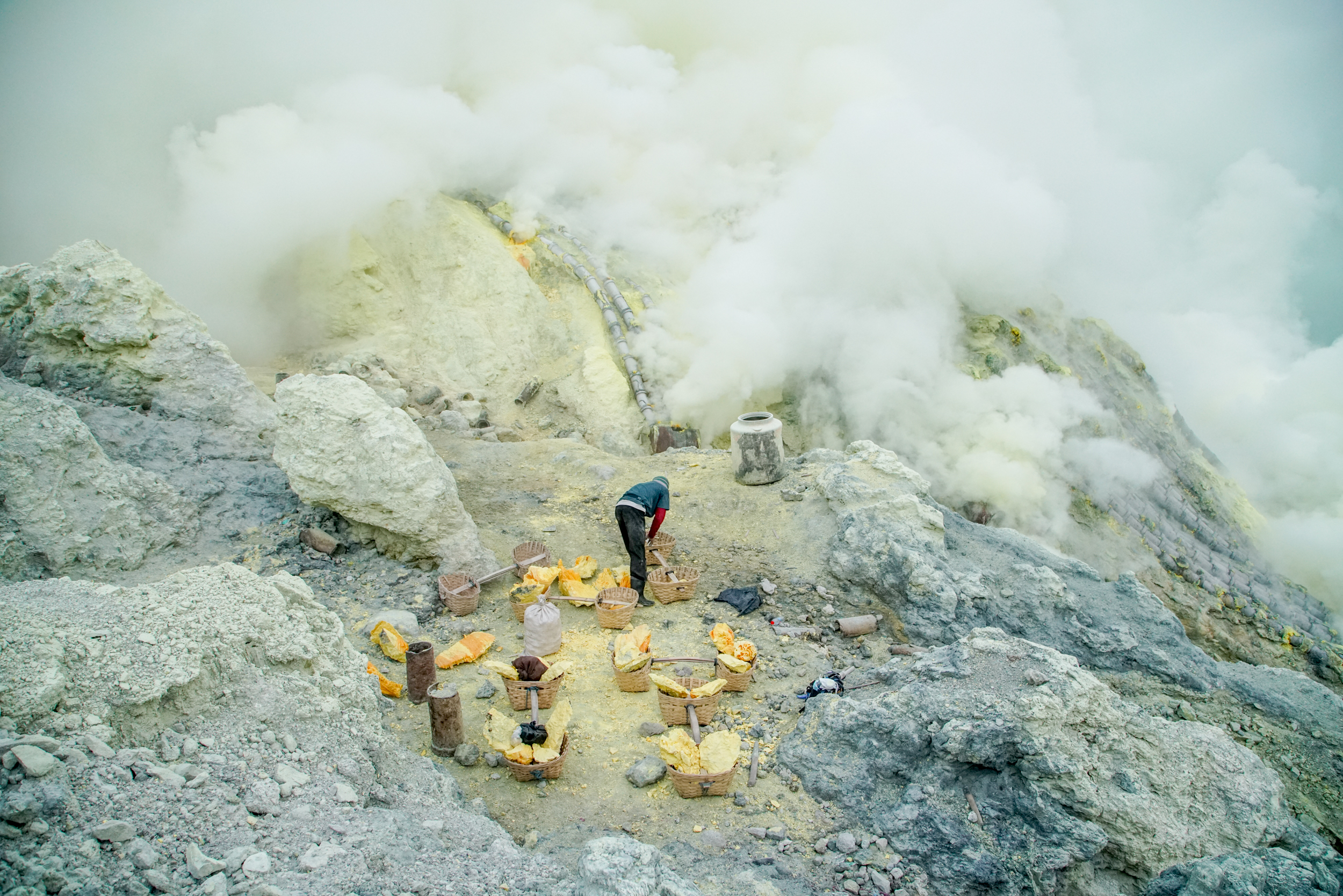 A miner organises his sulfur just after dawn in the crater of Kawah Ijen.