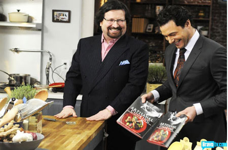 Terrance showing off his book, Artisanal Cooking, on Bravo's  Rocco's Dinner Party.