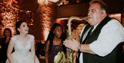 Dallas-Wedding-Band-Sax-with-Bride-400x275_c.jpg