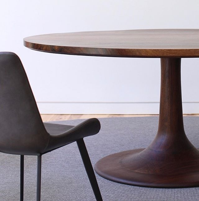 revisiting the beautifully brazen black walnut dining table with its delicately beveled edge and soft curves. #linkinbio