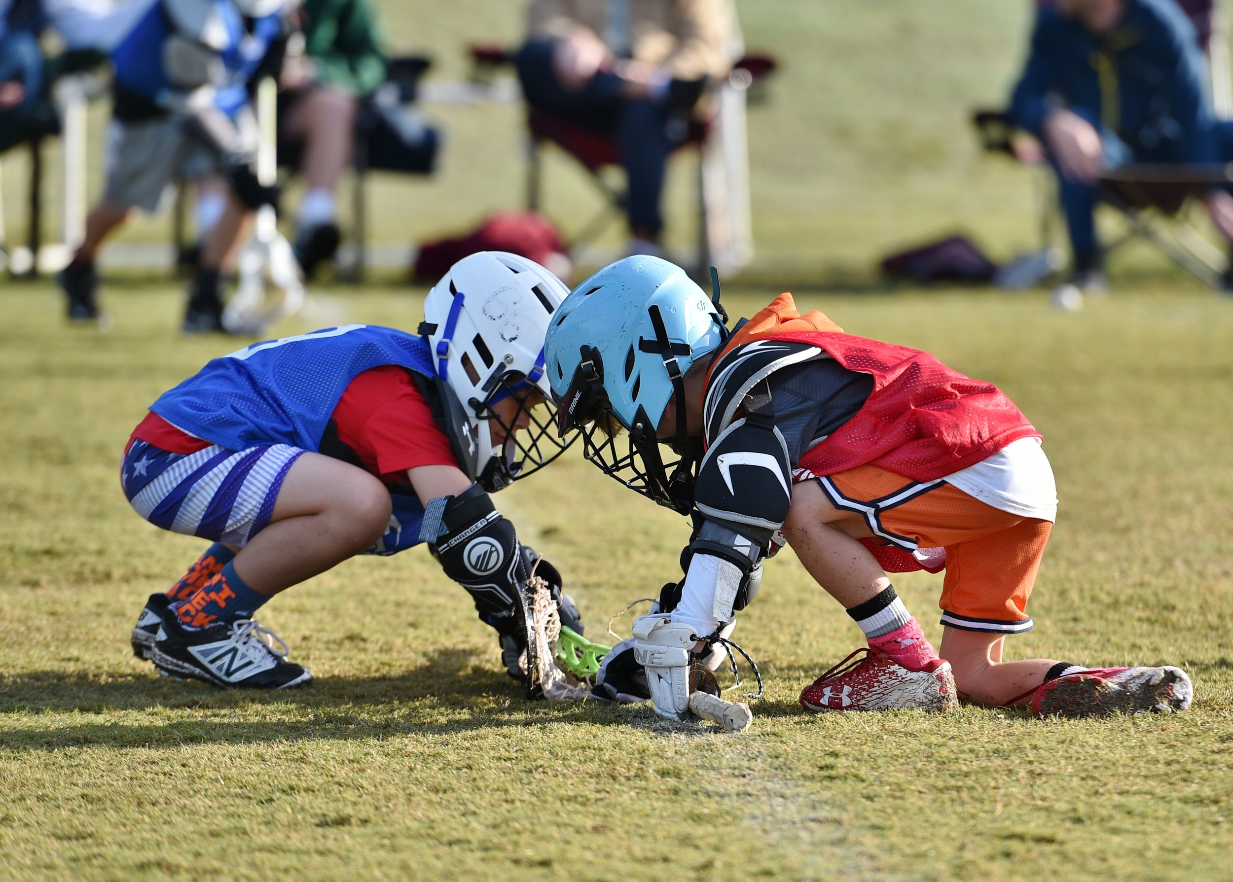 Two, K5-2nd grade players taking a face-off!