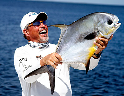 A happy angler with a permit caught fishing in Belize