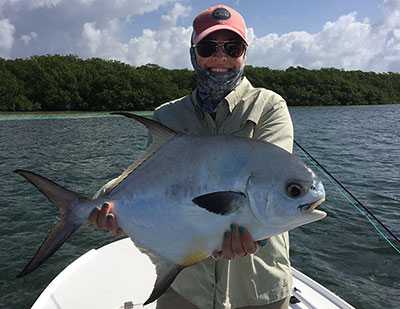 Big permit caught by a happy fly angler